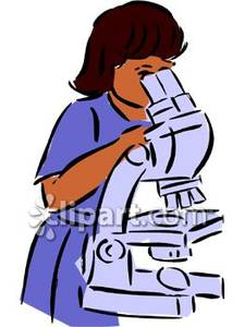 A Lab Technician Looking Through a Microscope Royalty Free.