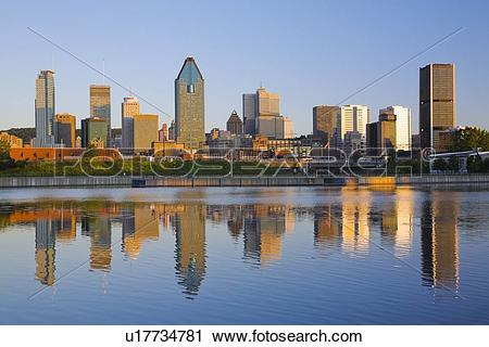 Stock Photography of Montreal Skyline and Lachine canal at sunrise.