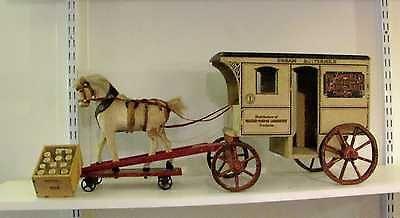"""Rare schoenhut """"fairfield western maryland dairy"""" milk wagon."""