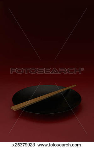 Stock Photo of Black lacquered bowl with chopstick x25379923.