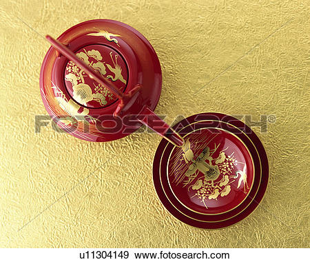 Stock Photograph of Lacquered sake pot and cups, high angle view.