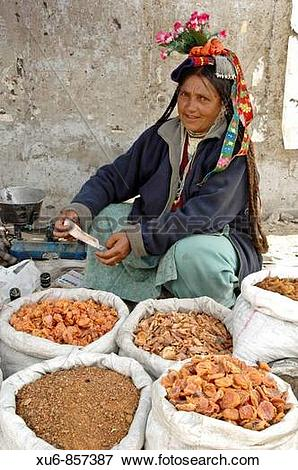 Picture of Ladakhi woman selling apricots in the market Leh.