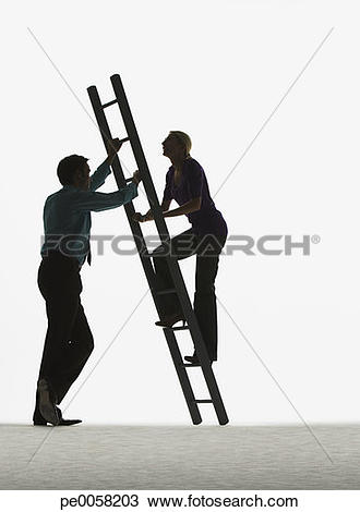 Stock Photo of Man holding a ladder while a woman climbs it.
