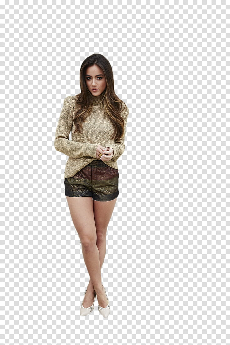 CHLOE BENNET, standing woman wearing gray sweater and brown.