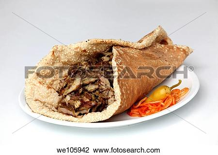 Stock Photo of Lamb and turkey shawarma in a Lafa flat Iraqi pita.
