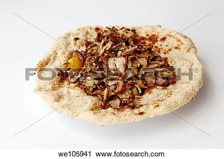 Stock Photography of Lamb and turkey shawarma in a Lafa flat Iraqi.