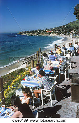 Stock Photograph of People dining at terrace restaurant in Laguna.