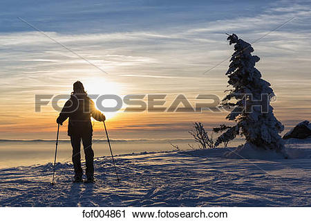 Stock Photography of Germany, Bavaria, Mature woman hiking on.