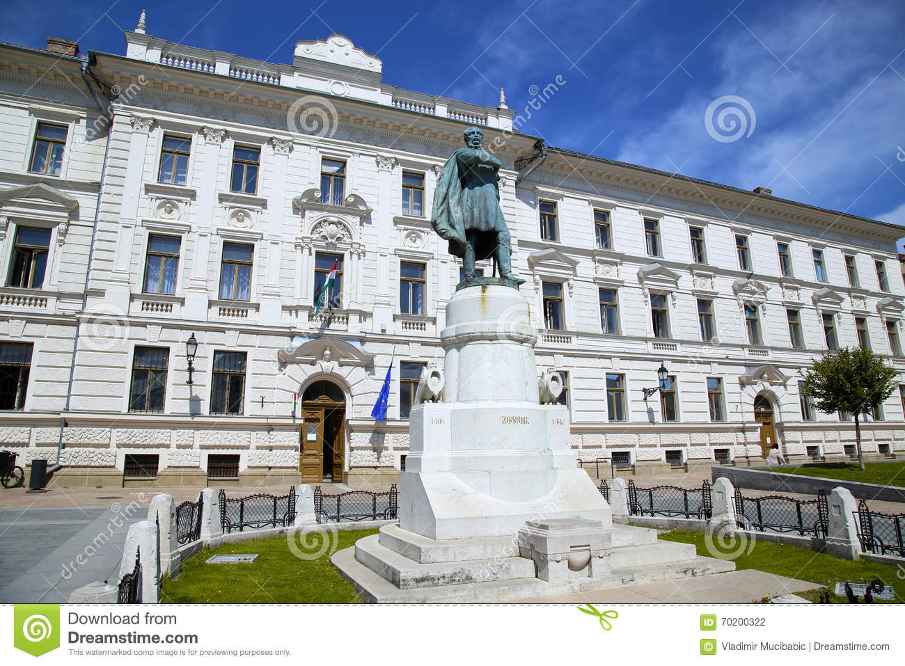 Statue Of Lajos Kossuth And Governmental Building In Pecs, Hunga.