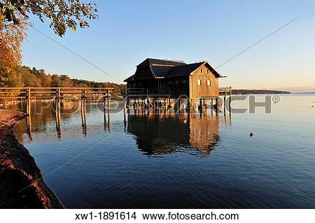 Stock Photo of wooden boathouse on the shore of Lake Ammer, Stegen.