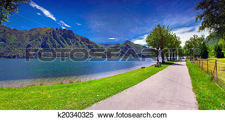 Stock Image of Summer sunny day in the park at Lake Idro k20340325.