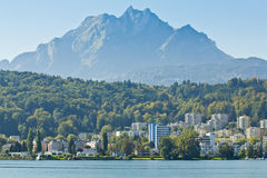 View Of Lucerne From Lake Lucerne And Switzerland Flag Stock Photo.