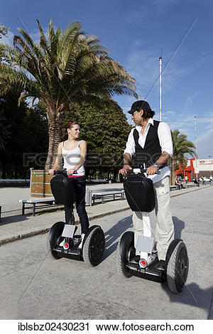 "Stock Photography of ""Couple on Segways, Segway tour at Lake."