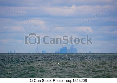 Pictures of Toronto skyline across Lake Ontario.