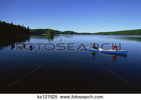 Stock Image of Elderly couple fishing on Canoe Lake, Algonquin.
