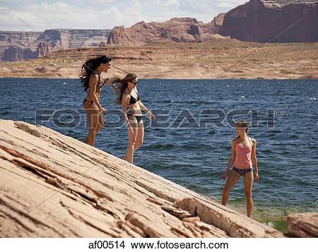 Stock Photo of USA, Utah, Lake Powell, Three young women in bikini.