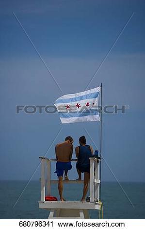 Stock Photography of Tourists standing on a lifeguard hut, Oak.