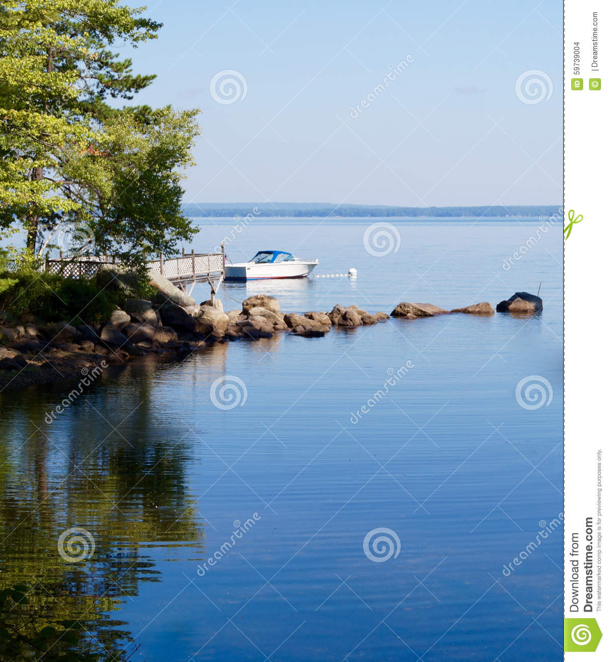 Tranquility, Serenity, Solitude And A Rocky Lake Cove Stock Photo.