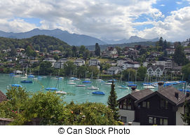 Stock Image of vintage town landscape around lake Thun.
