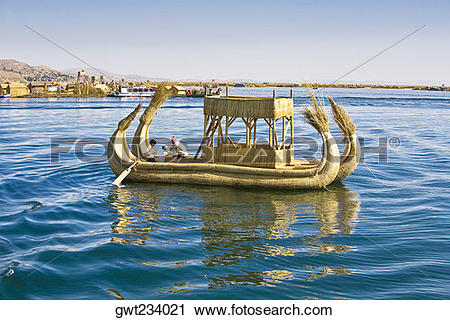 Stock Photography of Two men rowing a reed boat, Lake Titicaca.