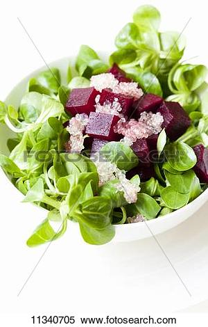 Stock Image of Lamb's lettuce with diced beetroot and lime caviar.
