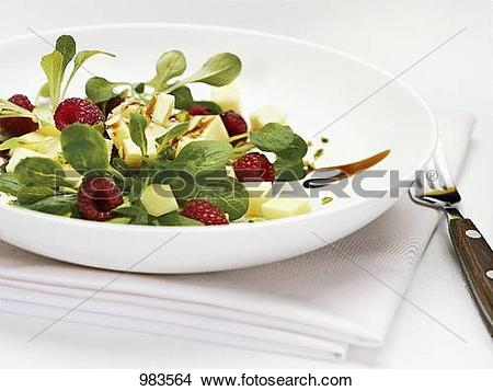 Stock Photo of Lamb's lettuce with cheese and raspberries 983564.