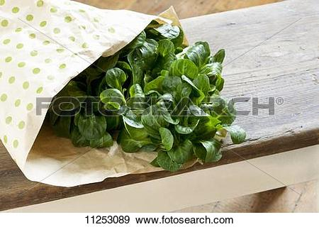 Stock Photograph of Fresh lamb's lettuce in a paper bag 11253089.