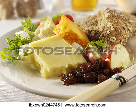 Stock Photography of Traditional Ploughman's lunch with Cheddar.