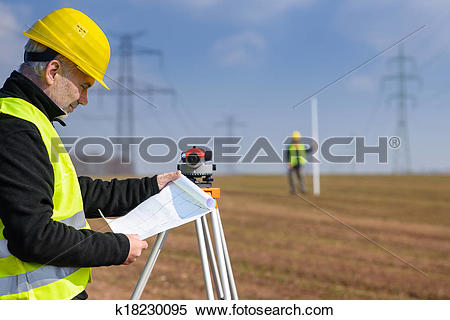Stock Image of Geodesist measure land on construction site.