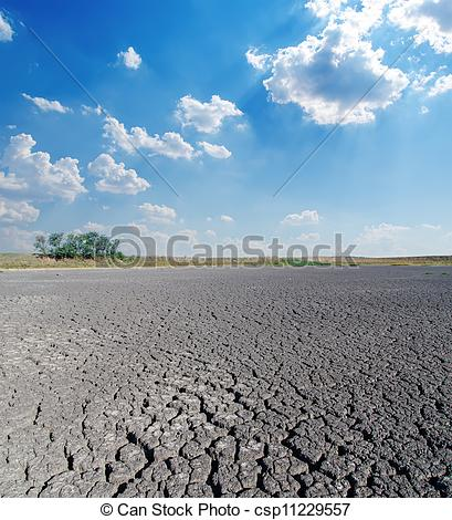 Stock Images of drought land under cloudy sky csp11229557.
