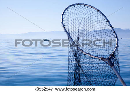 Picture of fishing landing net in blue sea k9552547.