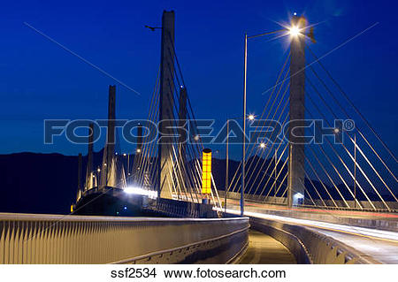 Stock Photo of Golden Ears Bridge with traffic at night, motion.