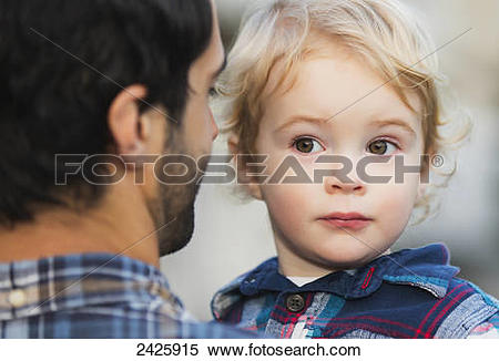 Stock Image of Father carrying his young son; Langley, British.