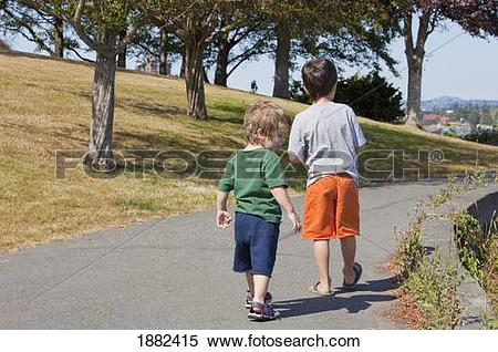 Stock Image of Two Boys Walking On A Trail; Langley, British.