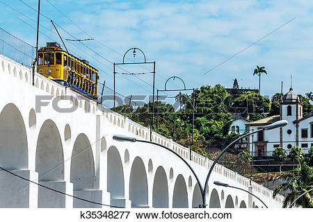 Picture of Train drives along distinctive white arches of the.