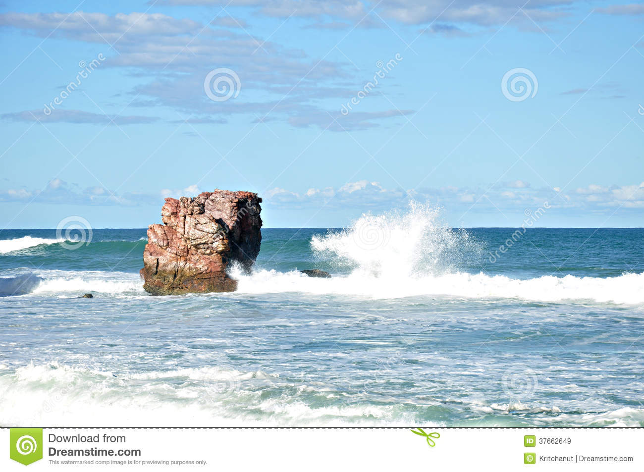 Small Waves Lapping On The Rocks In Blue Sea Royalty Free Stock.