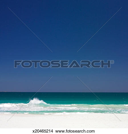 Stock Photo of Waves lapping shore x20465214.