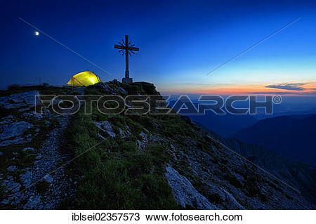 "Stock Photo of ""Blue hour with a mountain panorama and a tent at."
