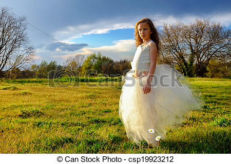 Stock Photography of Young girl wearing white dress in late.