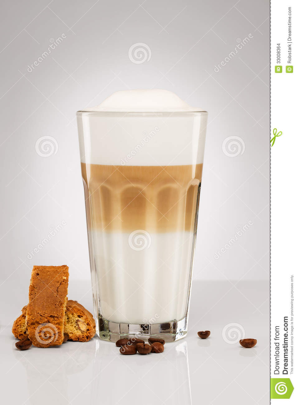 Latte Macchiato With Coffee Beans And Cookies Stock Images.