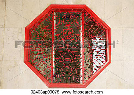 Pictures of Octagonal window with lattice work showing Buddha.