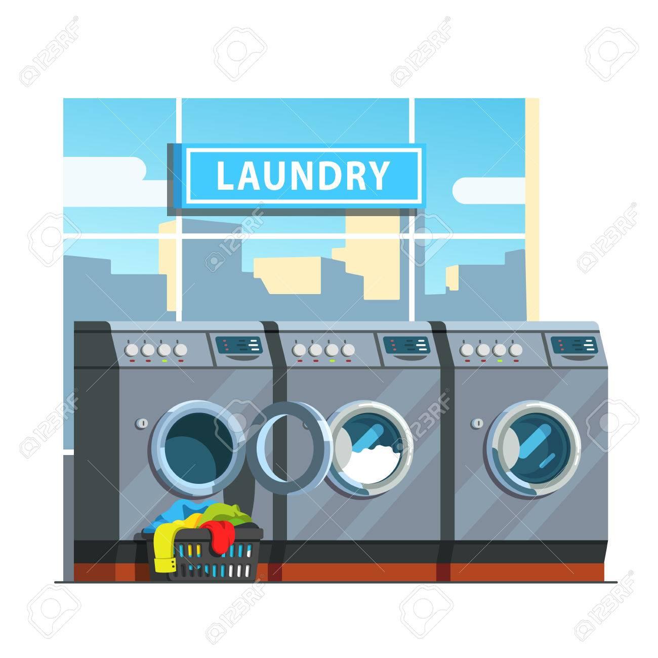 Public laundromat line of washing machines. Laundry basket with...
