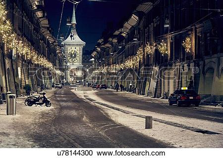 Stock Photography of Night time view of christmas lights in street.