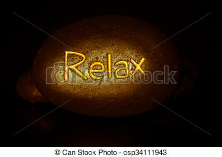 Stock Photo of relax written on lava stone.