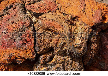 Stock Images of Lanzarote lava stone red rusty color texture.