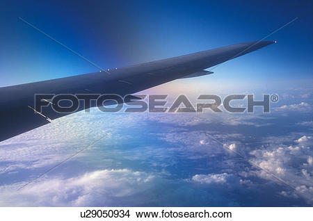 Stock Photo of airplane, The wing of a US Airways plane flys over.