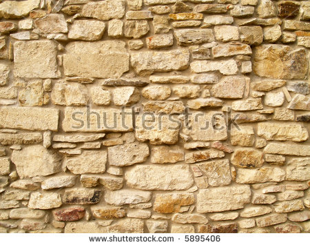 Horizontal View Of A Layered, Sandstone Exterior Wall Building.