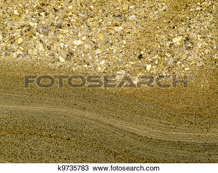 Stock Photo of Smooth surface of layered sandstone sediment rock.