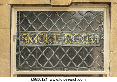 Stock Photography of Old gold smoke room sign in an old leaded.