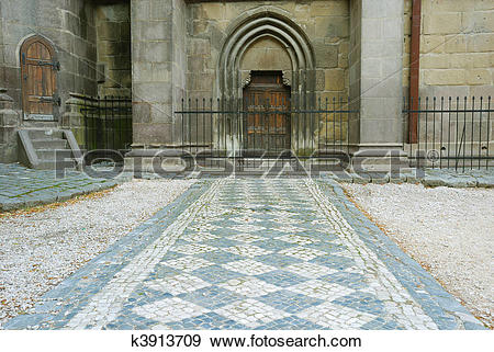 Stock Photograph of leading lines rock pavement to old medieval.